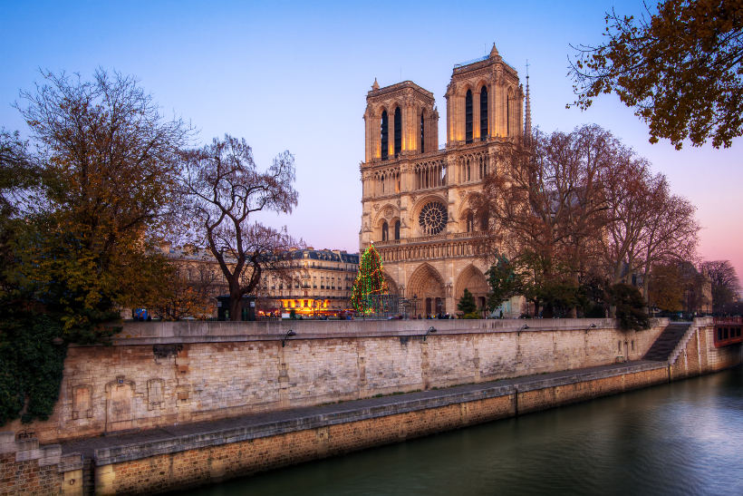Travel Associates notre dame Paris at dusk
